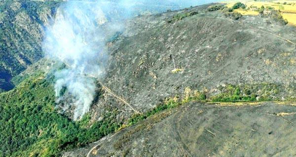 Photo of Controlado o lume do Navea, en Trives
