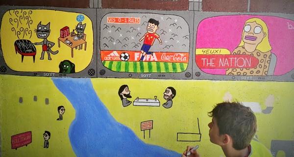 Photo of A creatividade e a cor toman as paredes dun dos pasos subterráneos do tren no Barco