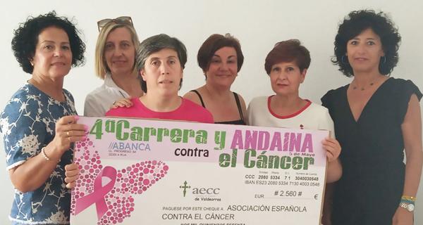 Photo of O Atletismo Rúa entrégalle á AECC os 2.560 euros recaudados na carreira e andaina contra o cancro